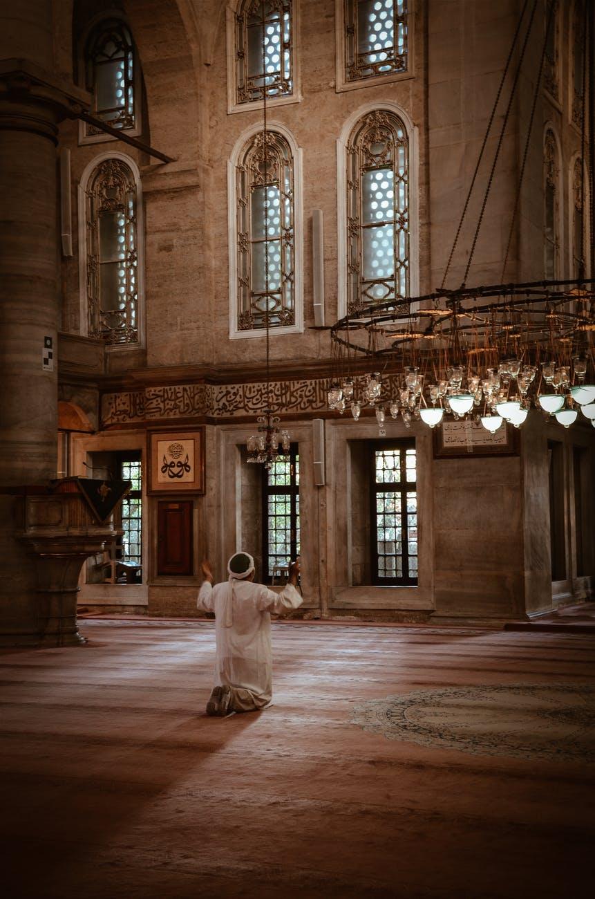 person kneeling inside building